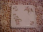 Antique porcelain trivet with florals