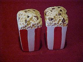 Bags of popcorn, salt and pepper shakers