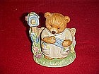 Sealed with a kiss, bear mailing letter figurine