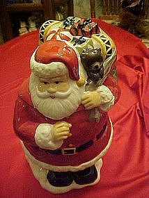Santa Claus with bag of toys, cookie jar