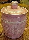 Pink and white glazed ceramic cookie jar