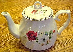 China teapot with red roses and florals