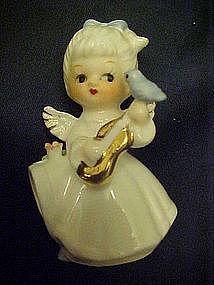 Tiny bone china angel with bluebird