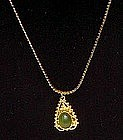 Jade  and gold tone necklace