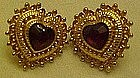Goldtone heart earrings with ruby red rhinestone center