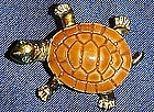Adorable gold tone turtle pin with rhinestone eyes