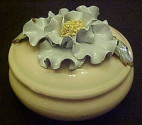 Vintage ceramic powder jar with blue flower top