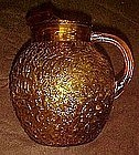 Large Milano, dark amber ball pitcher textured