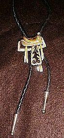 Nice western saddle bolo tie w/leather braid