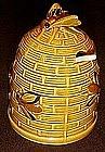 Vintage beehive with bees, ceramic honey jar