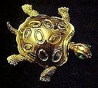 Gold tone turtle tortoise pin with rhinestone eyes