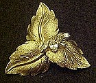 Gold tone leaf pin with rhinestone accents
