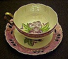 Vintage Enesco lustre, three legs cup and saucer set