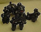 Black glaze poodle figurines family, red clay