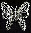 Delicate Monet silvertone butterfly pin