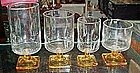 Assorted crystal glasses, square yellow bottoms