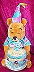 Winnie the Pooh plush, with musical Happy Birthday cake