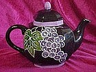 Hand painted ceramic teapot, black with fruits