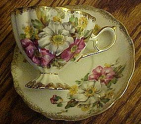 Fancy pedestal  teacup and saucer set,  multi florals