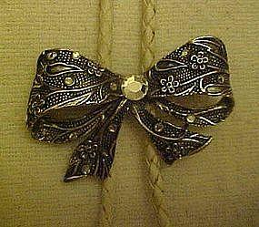 Silvertone bow with rhinestones, bolo tie