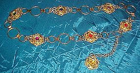 Goldtone metal filigree belt with faux rhinestones