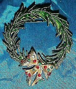 Evergreen wreath pin with rhinestone bow