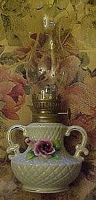Miniature ceramic oil lamp, with applied pink rose