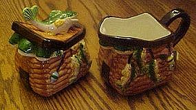 Fishing themed ceramic creamer and sugar, creel