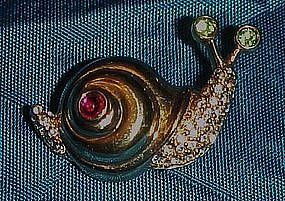 Adorable snail pin with rhinestone accents