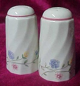 Swirl salt and pepper shakers with flowering vines