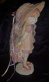 Little girl figurine with real straw hat