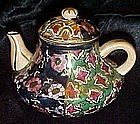 Highly decorated porcelain teapot, display /childs