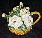 Basket of white cammilia's or rose's, ceramic teapot