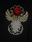 Small goldtone filigree angel pin. Ruby rhinestone