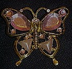 Pretty goldtone butterfly pin with pink accent stones