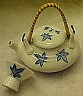 Individual tea pot with cup. Cobalt maple leaf pattern
