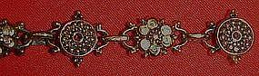 Vintage antiqued goldtone bracelet, aurora rhinestones