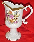 Footed  porcelain pitcher / vase with roses