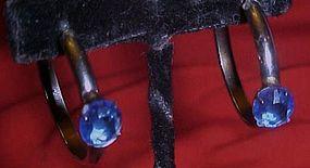 Silver tone hoop earrings with faux blue sapphire,