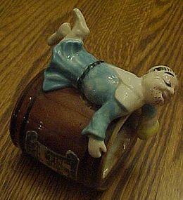 Kreiss Elegant Heirs ashtray, Man in dress on barrel