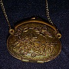 Vintage Corday solid perfume purse shaped pendant