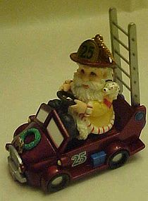 Fireman santa ornament driving fire truck