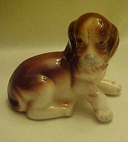Brown and white puppy ceramic figurine