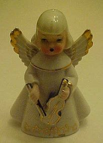 vintage angel figurine playing violin