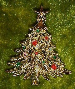Gold tone Christmas tree pin with rhinestones & jewels