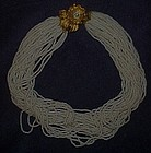 Vintage multi strand  bead  choker with flower clasp