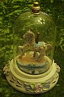 Carousel horse figurine in glass dome