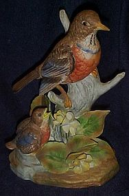 Large robin with baby porcelain bird figurine