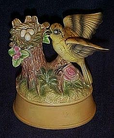 Musical porcelain bird figurine