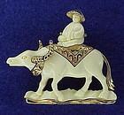 Hattie Carnegie Asian man riding a yak (water buffalo)